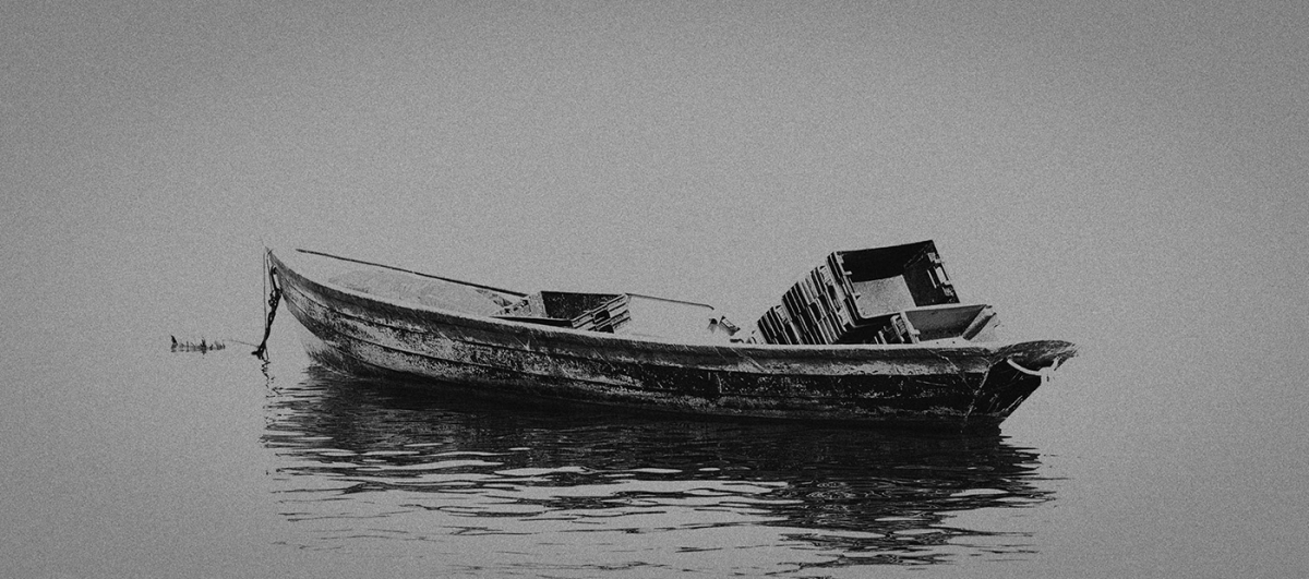 moody skiff in black and white