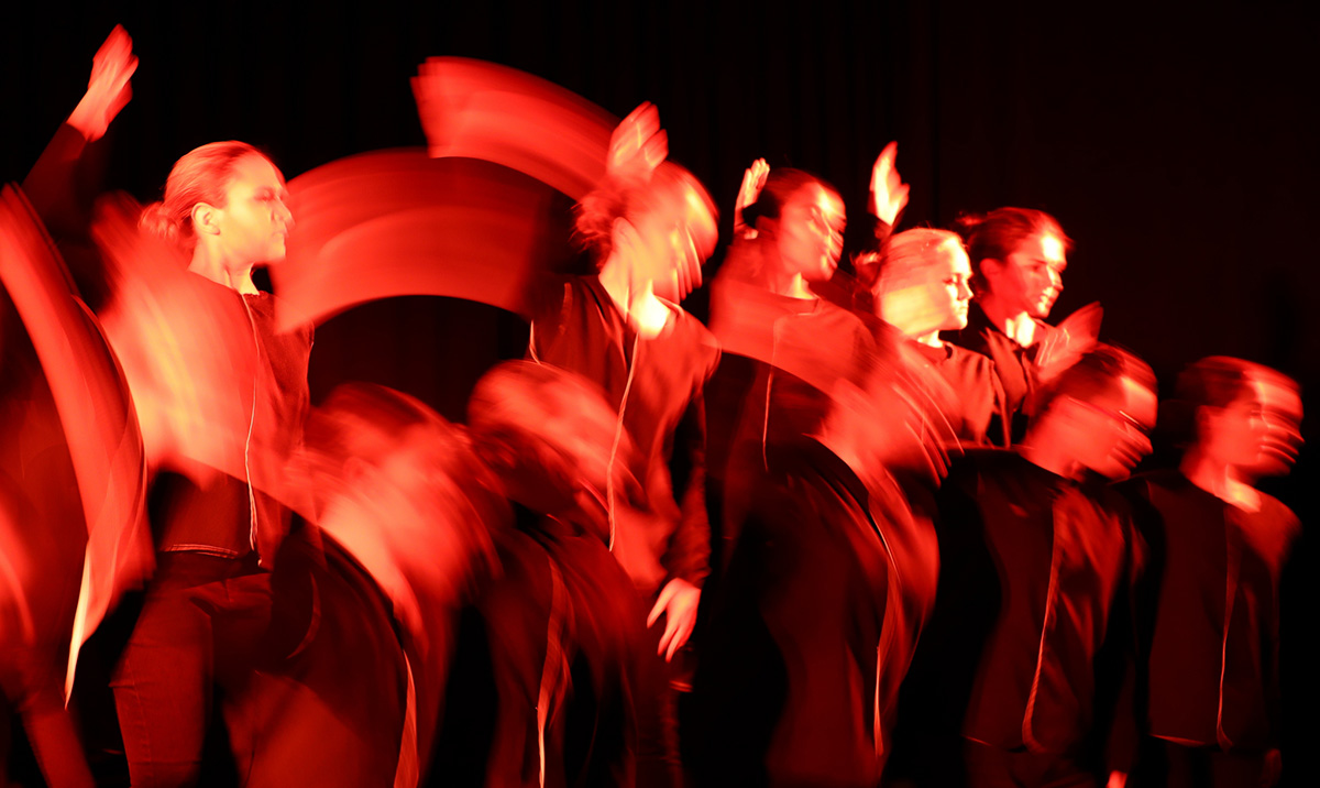 red blurred dancers