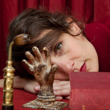 woman behind hand and pipe and book